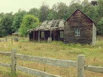 Old shack. Historic dilapidated weatherboard home from pioneer days in Australia stock photography