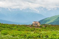 Old shack and mountains in Georgia Royalty Free Stock Photos