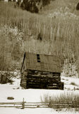 Old shack in snow. A view of an old  tumbledown shack on a mountainside in winter snow outside of Taos, New Mexico (USA).  Scanned from a black and white film Royalty Free Stock Photography