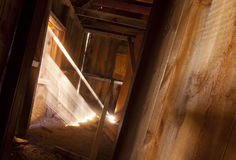 Old Shack Sun Beams. Sunlight streaming into an old abandoned shack Stock Images