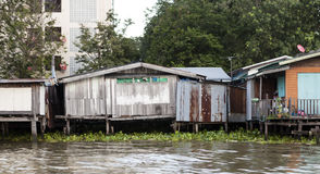 Old shacks, poor neighborhoods on the water of the river. Thailand Bangkok. Royalty Free Stock Images