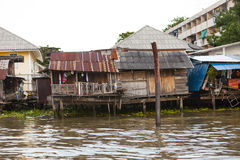 Old shacks, poor neighborhoods on the water of the river. Thailand Bangkok. Stock Images