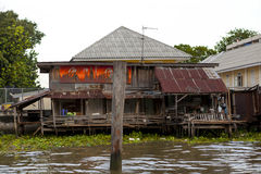 Old shacks, poor neighborhoods on the water of the river. Thailand Bangkok. Royalty Free Stock Photo