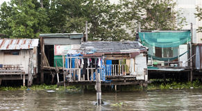 Old shacks, poor neighborhoods on the water of the river. Thailand Bangkok. Royalty Free Stock Photos