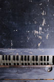 Old shattered piano background Stock Photo