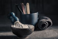 Old shave tools with grey soap, razor and brush. On a gray concrete background royalty free stock photos