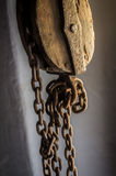 Old Sheave. With hanging rusty chains royalty free stock image