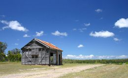 Old Shed. Old farm shed next to dirt road Royalty Free Stock Images