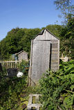 Old shed in an allotment. Old leaning shed in an allotment Royalty Free Stock Image