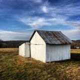 Old Shed. Blue shed farm sky Royalty Free Stock Photography