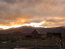 Old shed and farm at sunset. Royalty Free Stock Photography