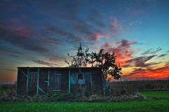 Old shed on a field at evening Royalty Free Stock Image