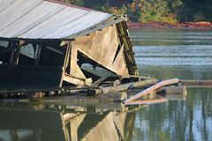 Rising River Damage. An old shed has collapsed by rising river levels royalty free stock image