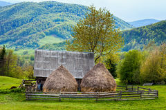 Old shed and haystacks Royalty Free Stock Images