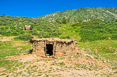 The old shed. The ramshackle shed, built of stone and clay, located on the foothill of Samak kishlak (village), Uzbekistan Royalty Free Stock Image