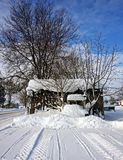 An old shed on a winter day. A wooden shed on a winter sunny day Stock Photo