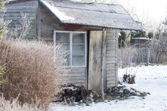 Old shed in the winter in the orchard Royalty Free Stock Image