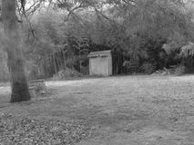 Old Shed By The Woods in Black and White. Black and white photograph depicting an old shed at the edge of the woods Royalty Free Stock Photos