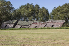Old sheds. Old weathered grain sheds leaning and decaying Stock Image