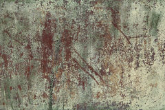 The old sheet, damaged by corrosion of steel with spots of exfoliating, faded green paint. Background for your design. The old sheet, damaged by corrosion of Stock Photo
