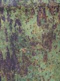 Old sheet of iron covered with a red-brown color with old green stained paint decaying metal, grunge background. Old sheet of iron covered with a red-brown color stock photos