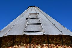 Old corn crib with metal sheet roof stock photo