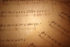 Old sheet music. Grunge background with Old sheet music Stock Image