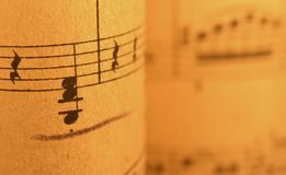 Old Sheet Music 2. Old print..close up of sheet music with warm lighting royalty free stock photos