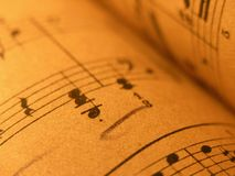 Old Sheet Music. Musical notation...old print...Close up of sheet music with warm lighting stock photos