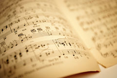 Old sheet music. Shallow depth-of-field. 11 x 16.5 inch image stock images