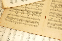 Old Sheet Music. Old discoloured and tatty paper printed sheets of music royalty free stock photo