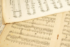 Old Sheet Music. Old discoloured and tatty paper printed sheets of music stock images