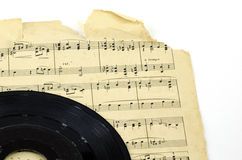 Old Sheet Music Record Deal. Old, tattered Sheet Music with Record Stock Photo