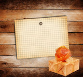 Old sheet of paper with gift box Royalty Free Stock Photography