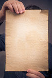Old sheet paper hands vertically Royalty Free Stock Photos