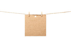 Old sheet of paper hanging Royalty Free Stock Photos