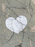 Old sheet of paper heart on stones texture Stock Images