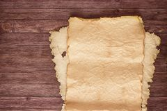 Antique blank parchment on aged wooden wall Royalty Free Stock Photos