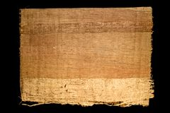 Old sheet of simple papyrus from Egypt isolated on a black background. Old sheet of simple papyrus from Egypt on a black background stock image