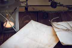 Old sheets of paper, books and candle Stock Image
