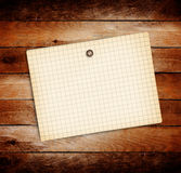 Old sheets of paper on wooden background Stock Photo