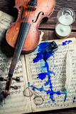 Old sheets and violin with ink and feather Stock Images