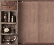 Old shelf with subjects. On a wooden background. monochrome royalty free stock photo
