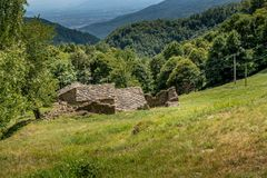 Old shelter for shepherds in the mountains of northern Italy stock images