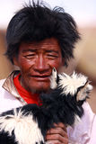 Old Shephard. The old Tibetan shepherd is holding the neonatal baby sheep in his arms. This is taken in Aug 2009 Stock Image