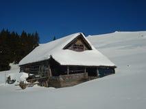Old shepherd hut on the winter. Old Shepherd shelter in winter in Latoritei mountains  Romania Royalty Free Stock Image