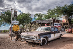 Old sheriff`s car with a Siren in Hackberry, Arizona. HACKBERRY, ARIZONA, USA - MAY 19, 2016 : Old sheriff`s car wreck with a siren left abandoned near the Royalty Free Stock Photography