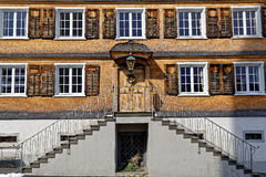 Old shingle house facade with external staircase royalty free stock photo