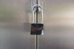 Old shiny metallic padlock. Securing metallic door Royalty Free Stock Photos