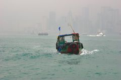 The old ship. The small ship in port of Hong Kong during time of a fog royalty free stock image